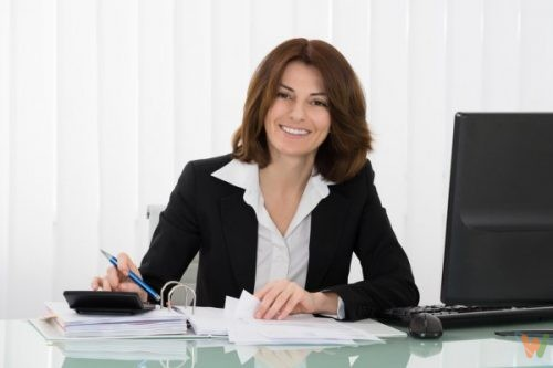 depositphotos_102983322-stock-photo-happy-businesswoman-calculating-tax
