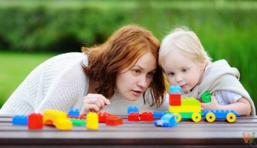 depositphotos_114803038-stock-photo-woman-with-his-son-playing